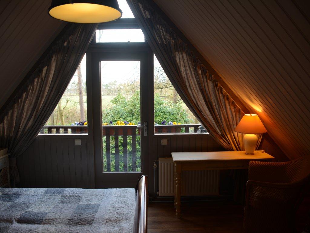 Schlafzimmer am ersten Stock, mit balkon